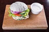 blue burger with sauce