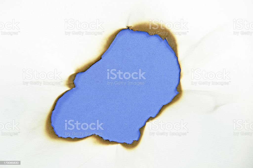 Blue Burned Hole stock photo