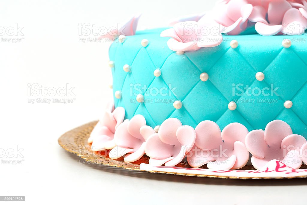 Blue cake with rose flowers isolated on white background stock photo