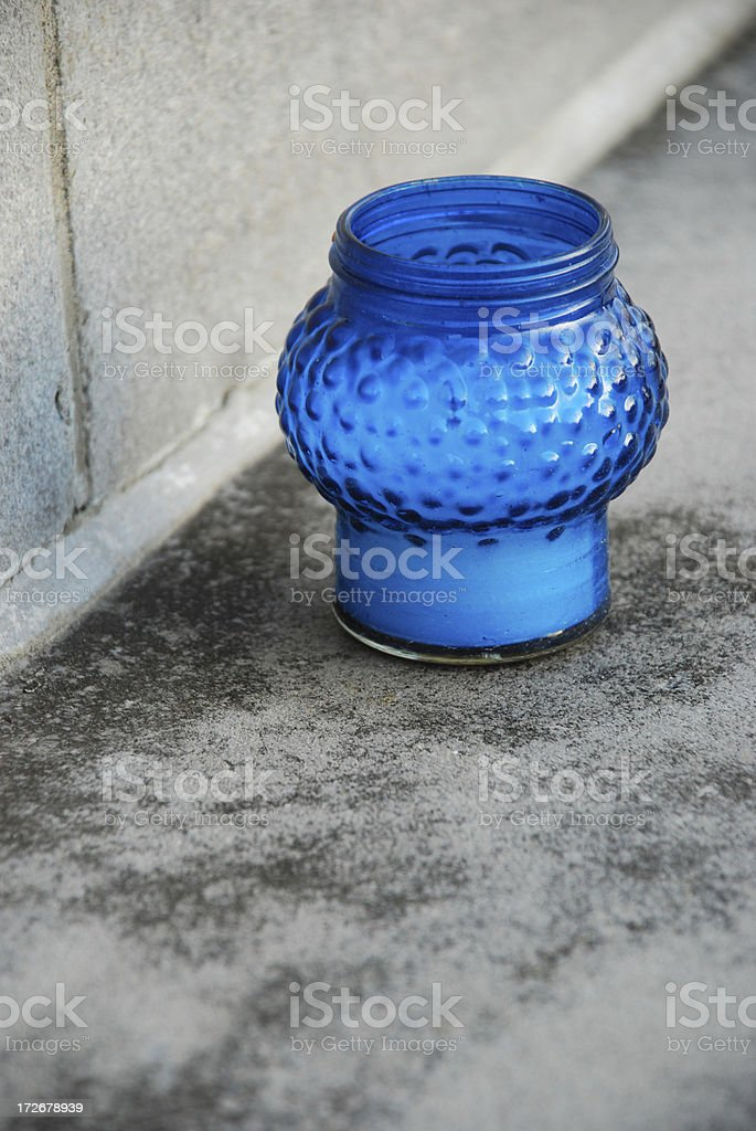 Blue candle at base of cenotaph. royalty-free stock photo