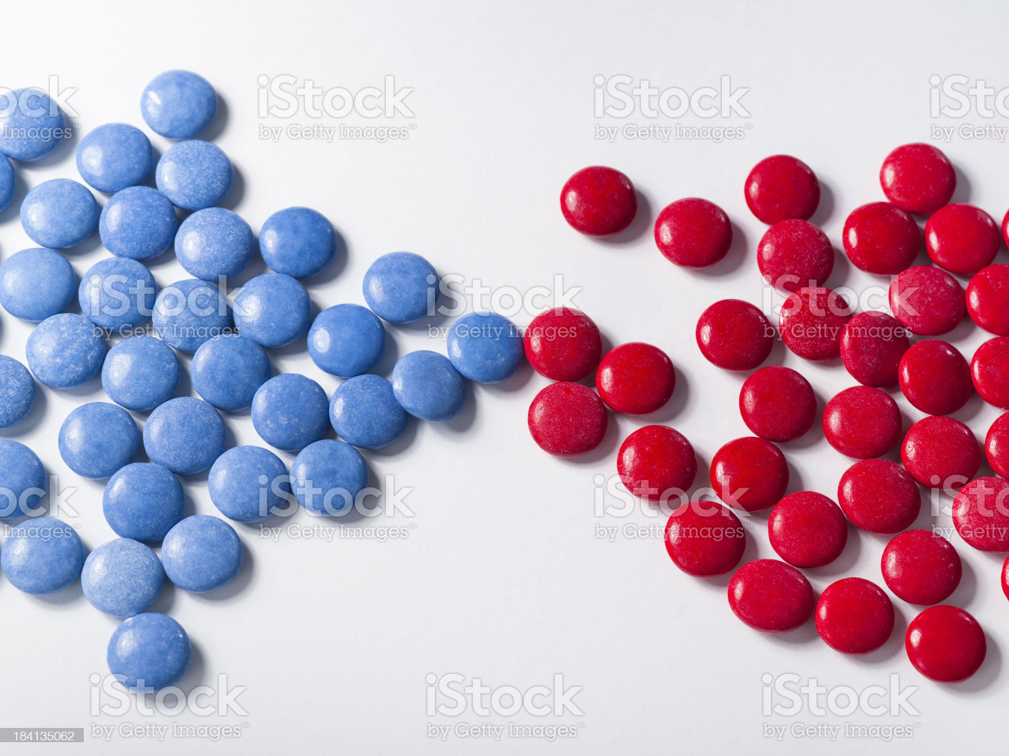 Blue candy with colorful red chocolates royalty-free stock photo
