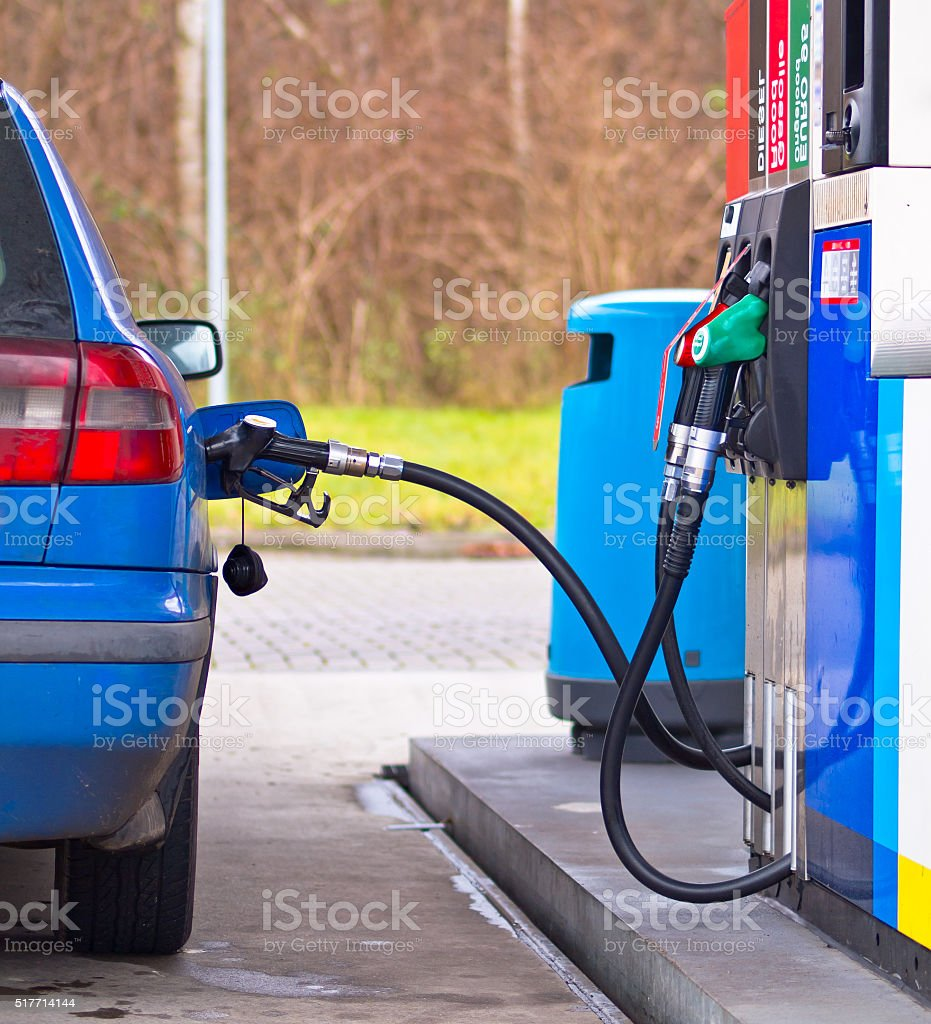Blue car at gas station stock photo