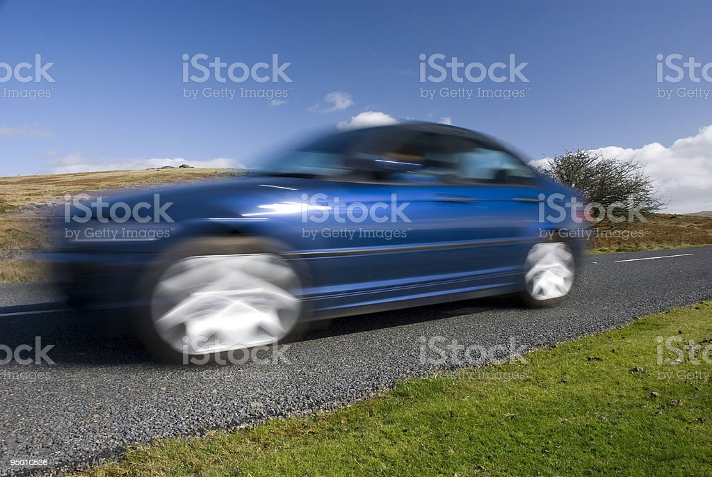 Blue car on the mountain road royalty-free stock photo