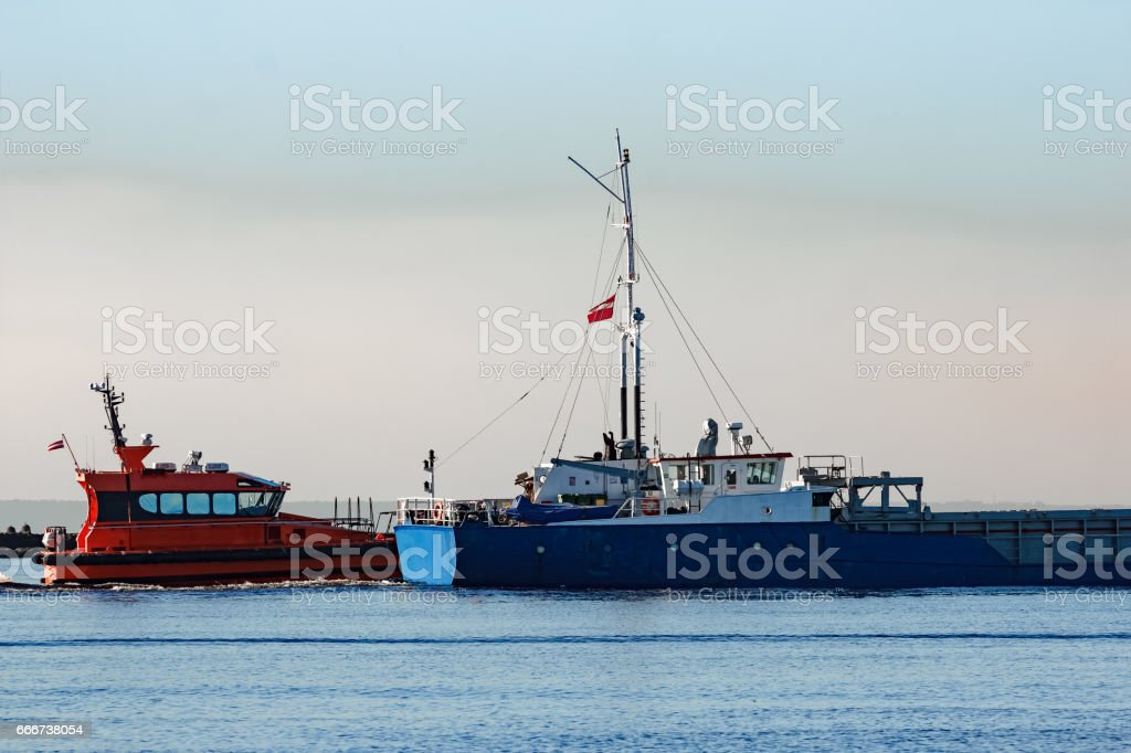 Blue cargo ship stock photo
