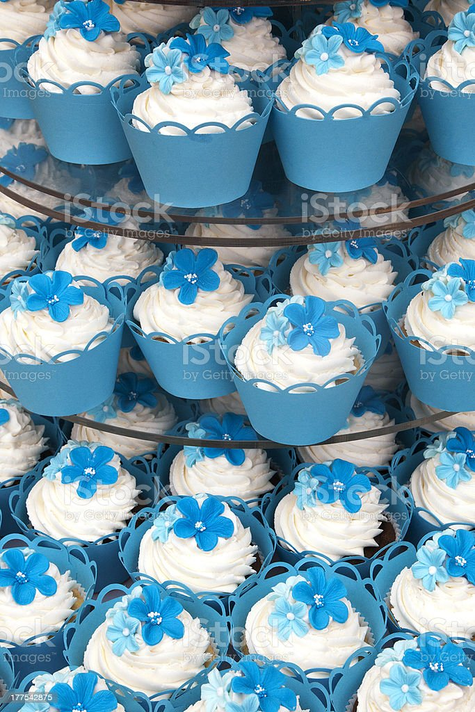 Blue cased cupcakes with flover detail on icing royalty-free stock photo