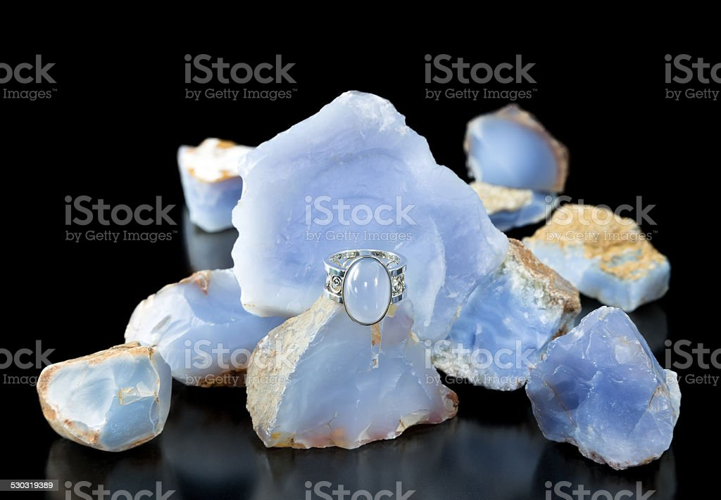 Blue Chalcedony Ring And Rough stock photo