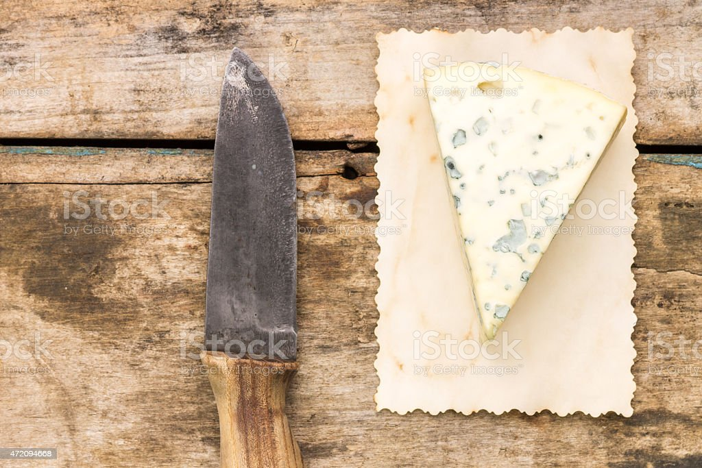 Blue cheese background with copyspace. stock photo