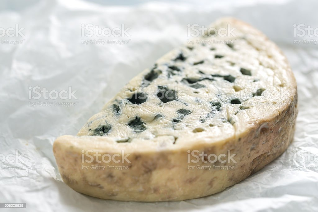 Blue cheese on the white paper stock photo