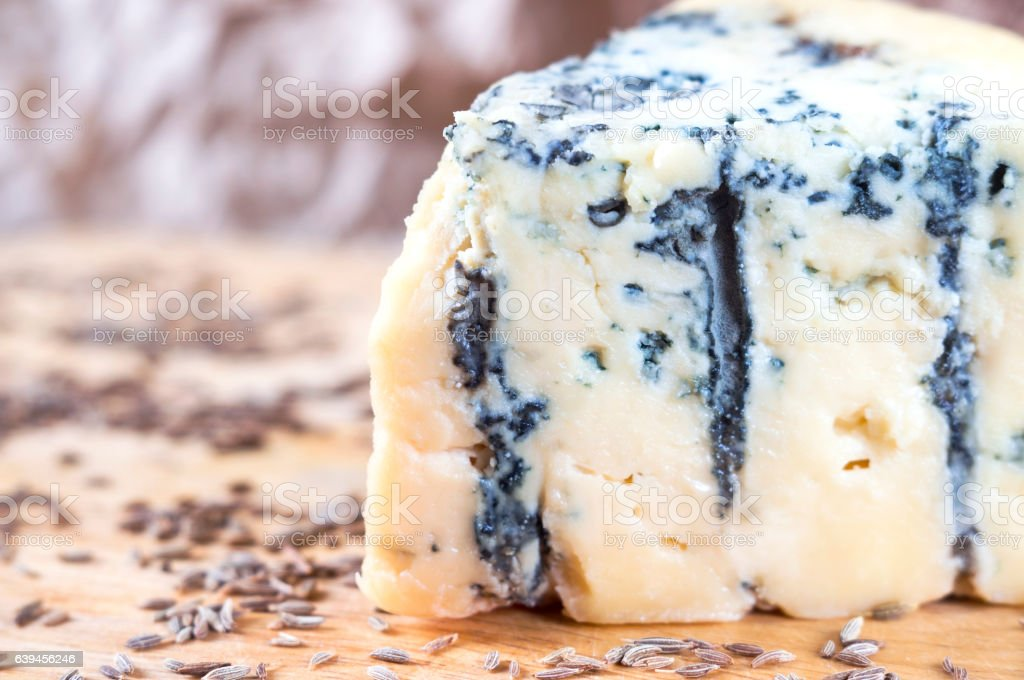 Blue cheese on wood board stock photo