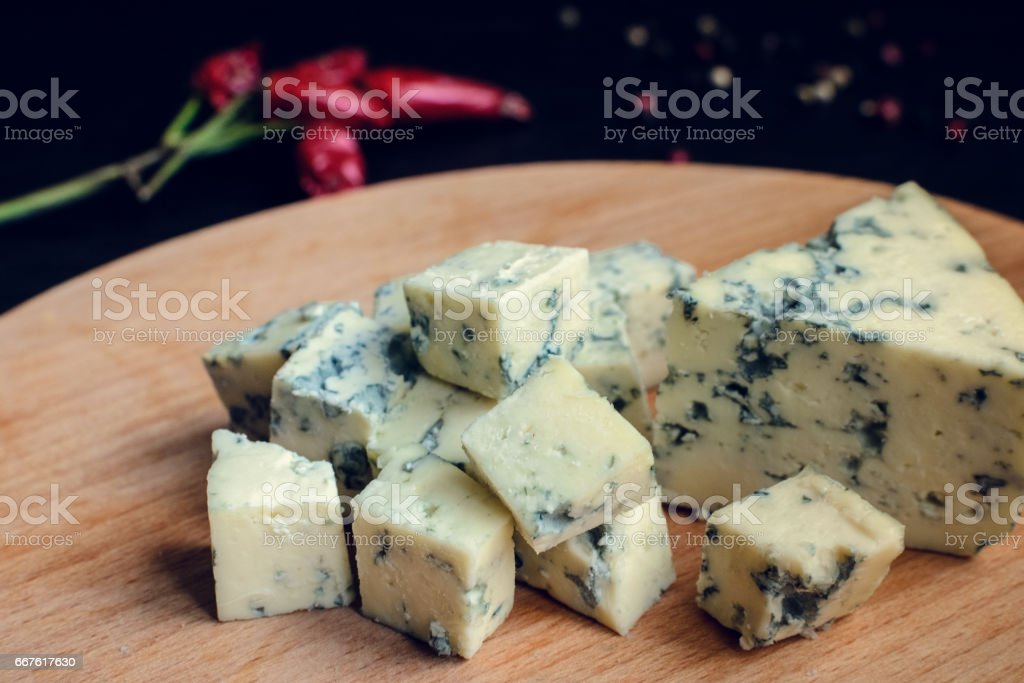 Blue cheese on wooden board stock photo