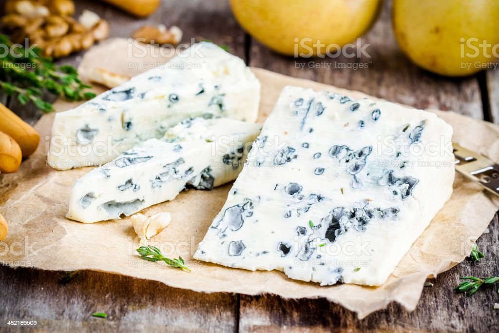 Blue cheese slices closeup stock photo