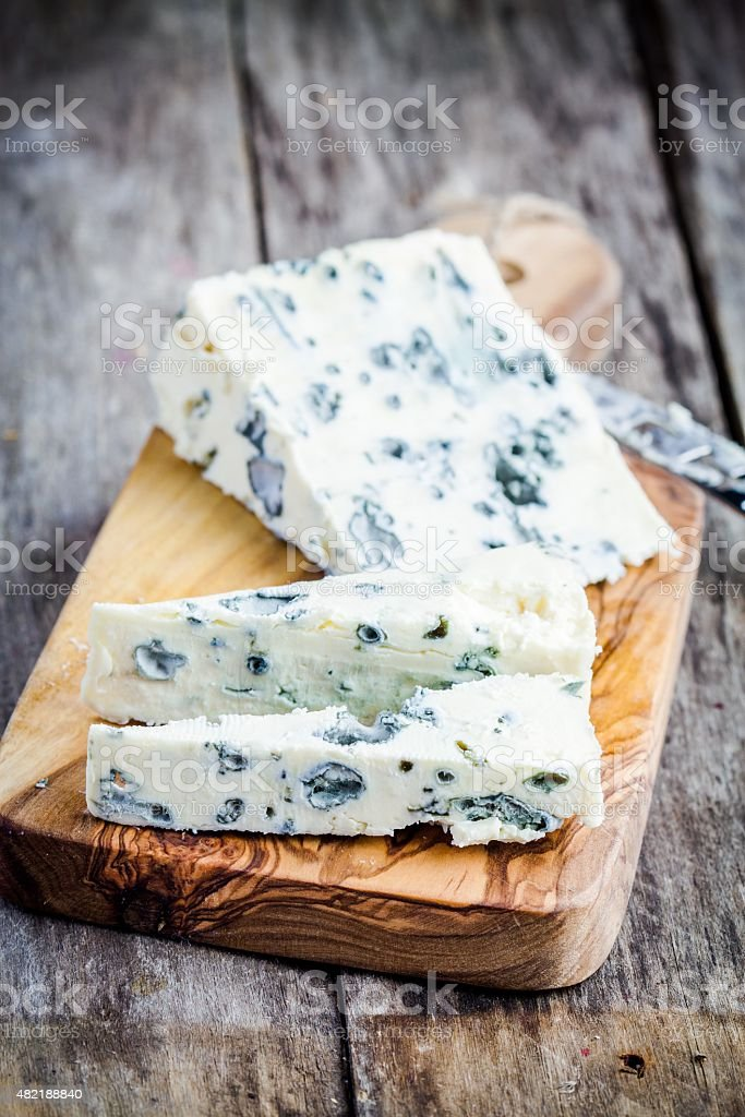 Blue cheese slices stock photo
