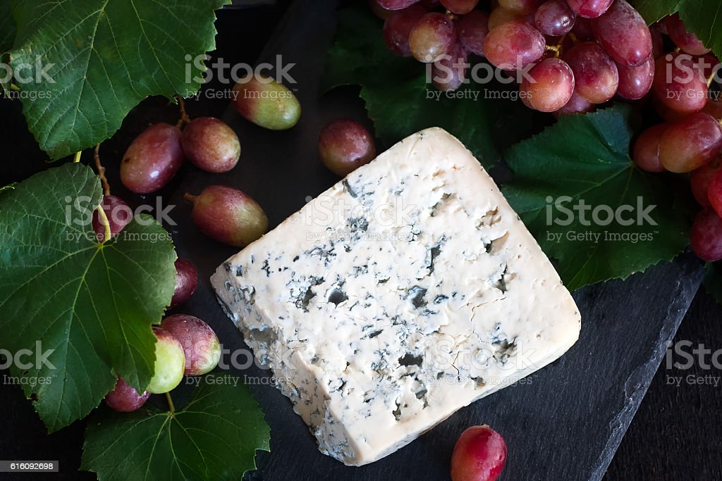 Blue cheese with grape background stock photo