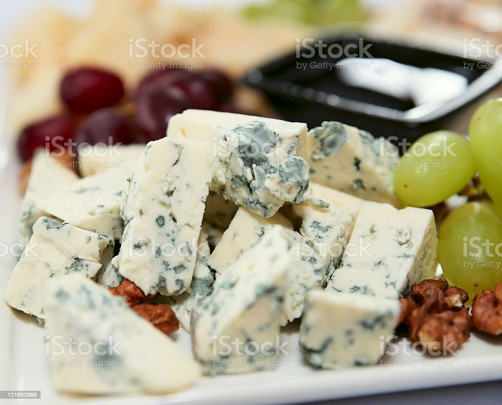Blue cheese with grapes and nuts stock photo