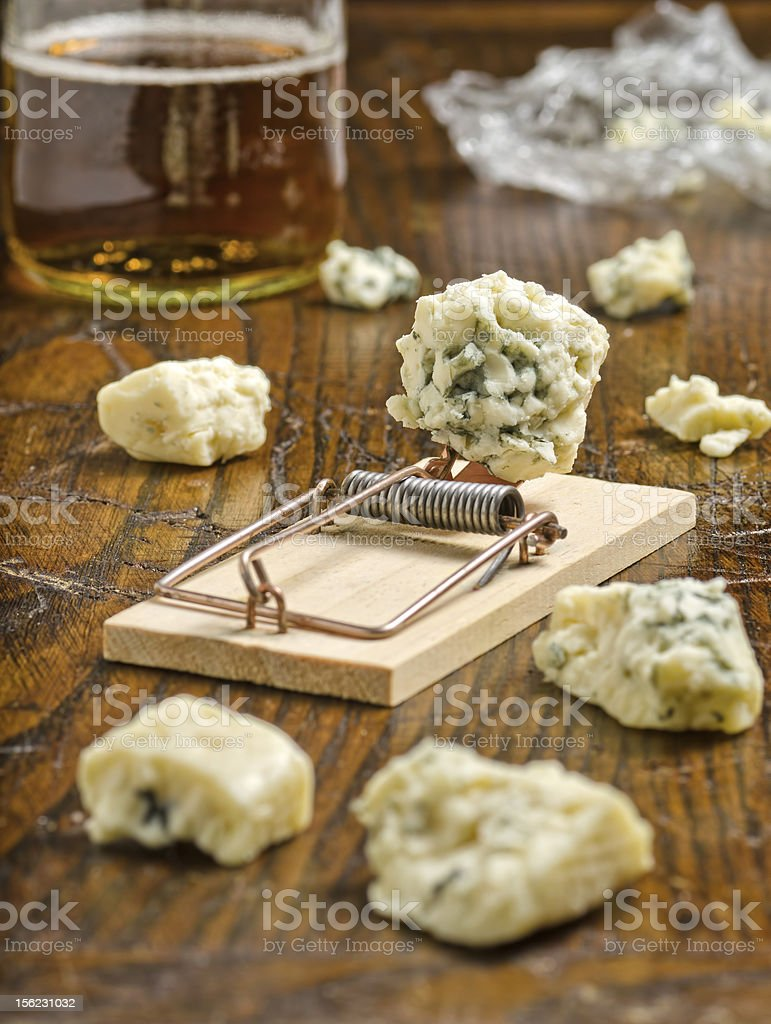 Blue cheese with mouse trap. royalty-free stock photo