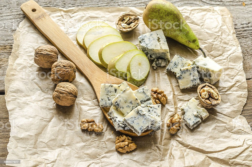 Blue cheese with pears and walnuts stock photo