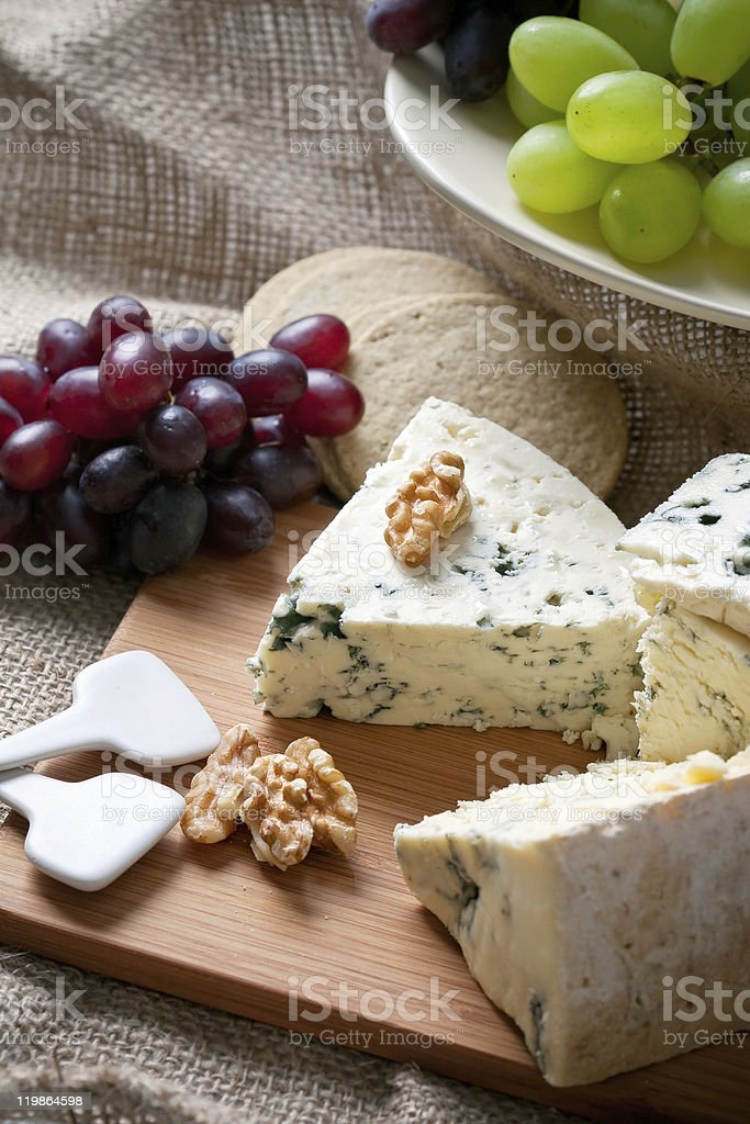 Blue cheese with walnuts and grapes stock photo