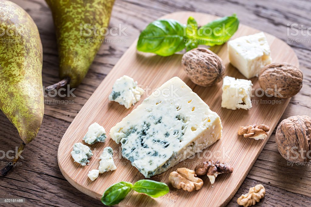 Blue cheese with walnuts and pears stock photo