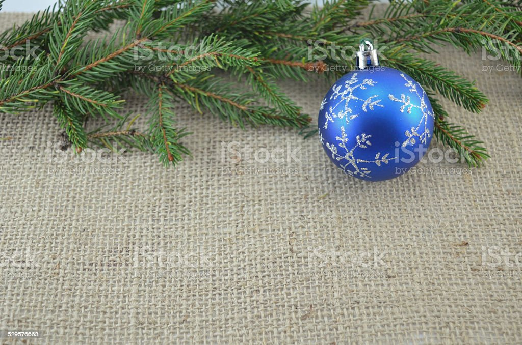 Blue Chirstmas ornament and a pine tree royalty-free stock photo