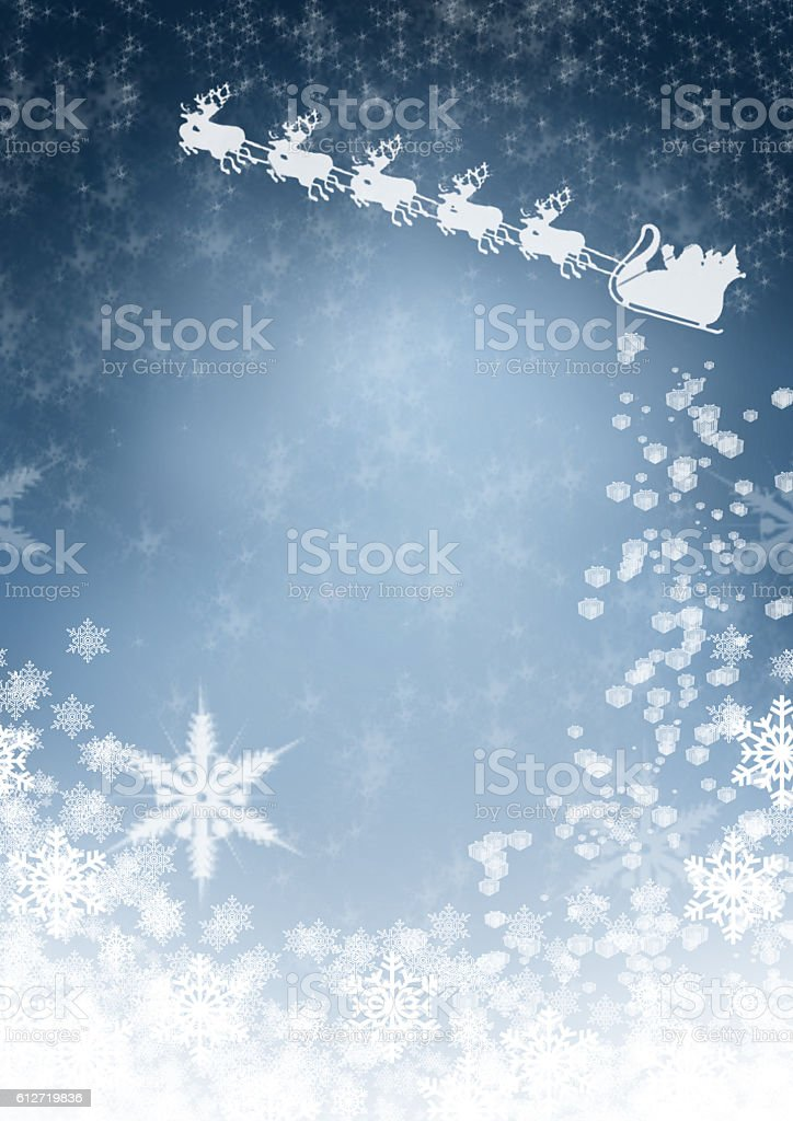 Blue Christmas background with a flying Santa Claus and reindeer stock photo