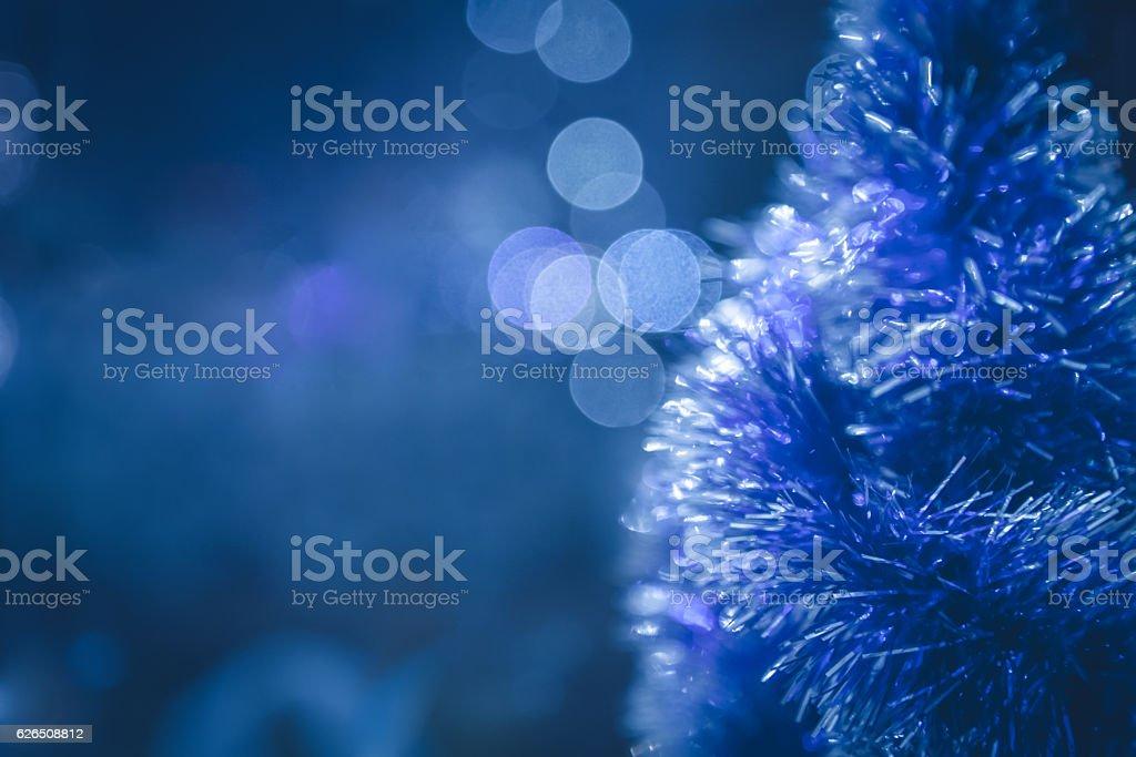 Blue Christmas background with Christmas tree and Christmas lights stock photo