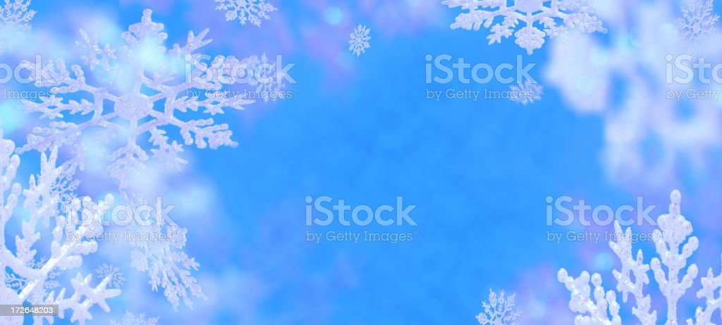 Blue Christmas background with white snowflakes royalty-free stock photo