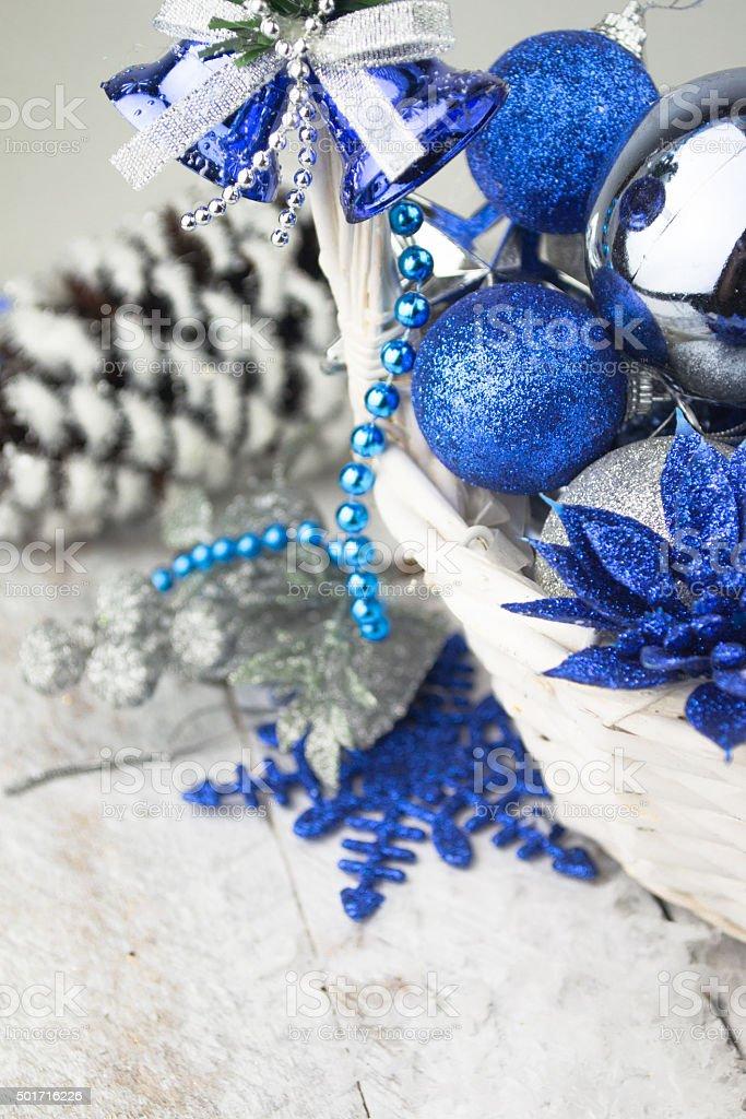 Blue Christmas balls in white wooden basket on white stock photo