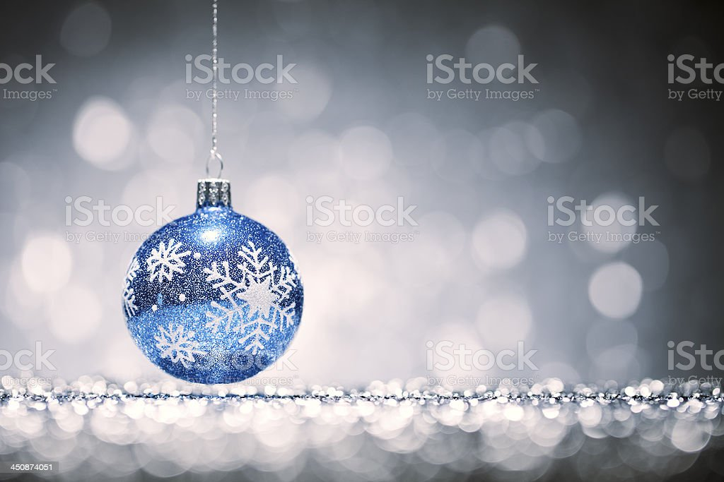 Blue Christmas Bauble - Glitter Bokeh Hanging Decoration royalty-free stock photo