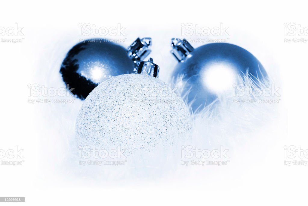 Blue Christmas baubles on a white fluffy background royalty-free stock photo