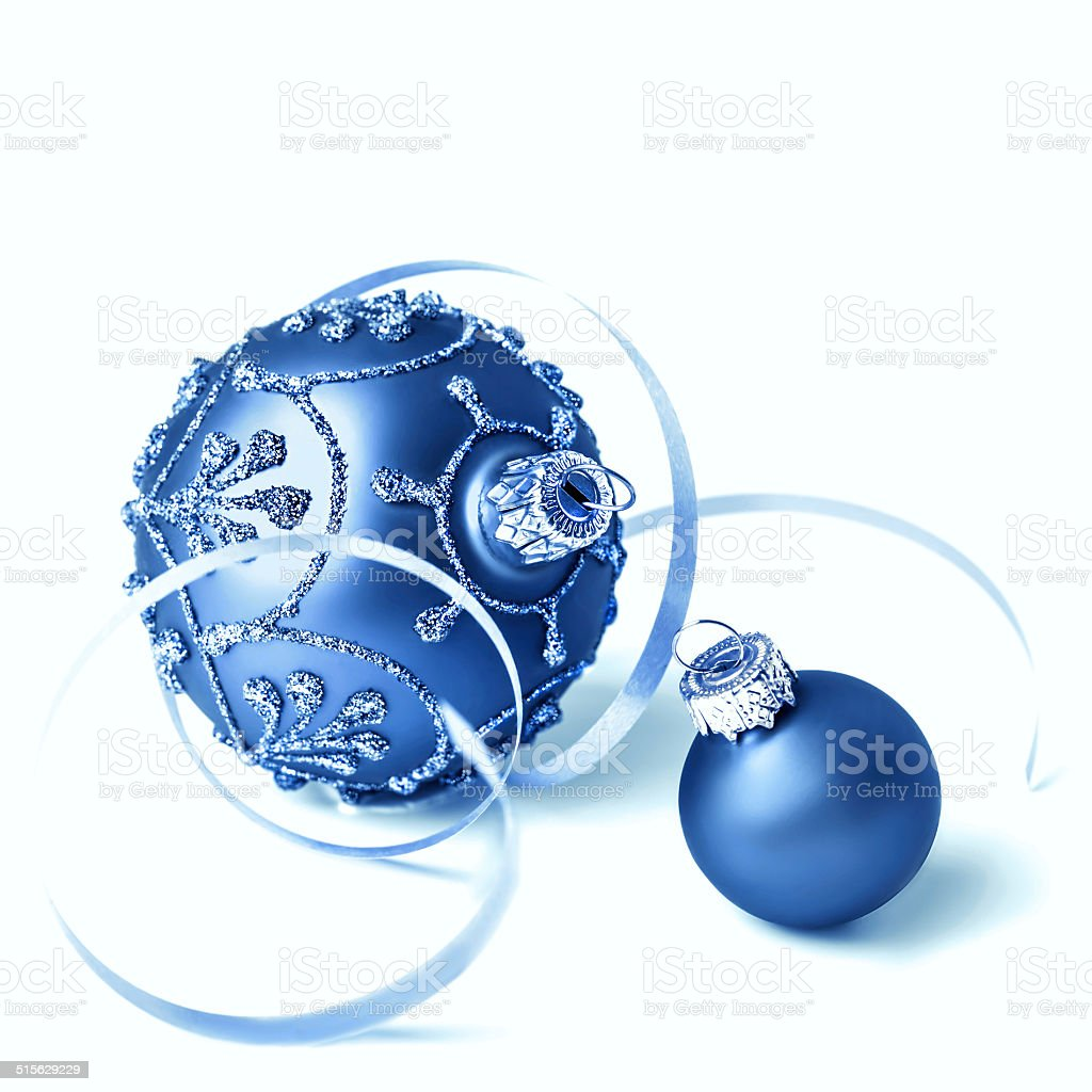 Blue Christmas baubles on white background stock photo