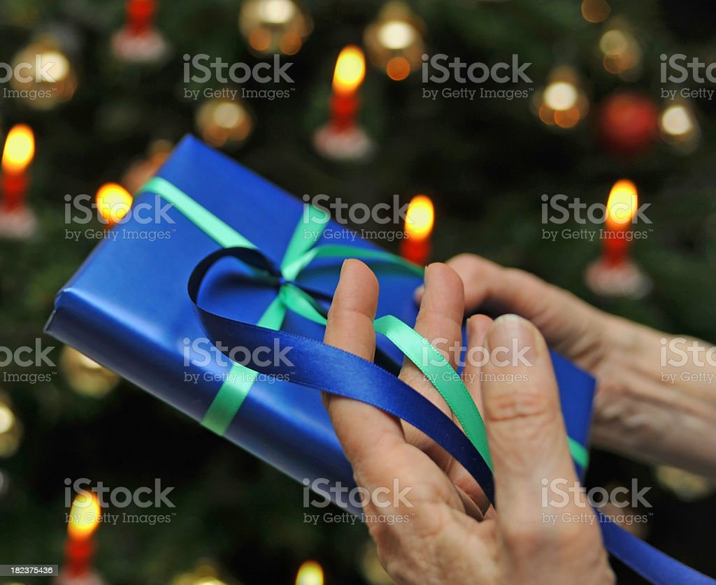 blue christmas gift in hand royalty-free stock photo