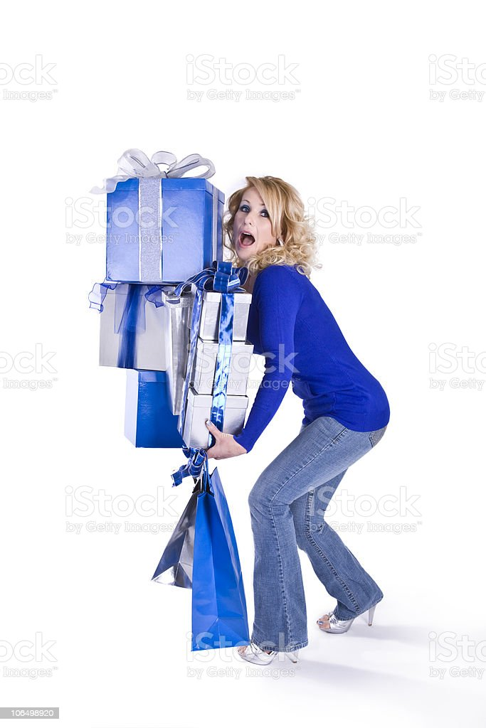 Blue Christmas - Girl with too many packages. royalty-free stock photo