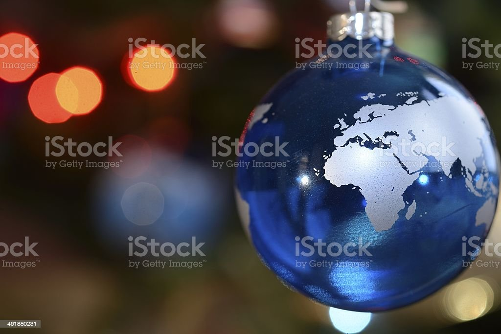 Blue Christmas ornament depicting the Earth stock photo