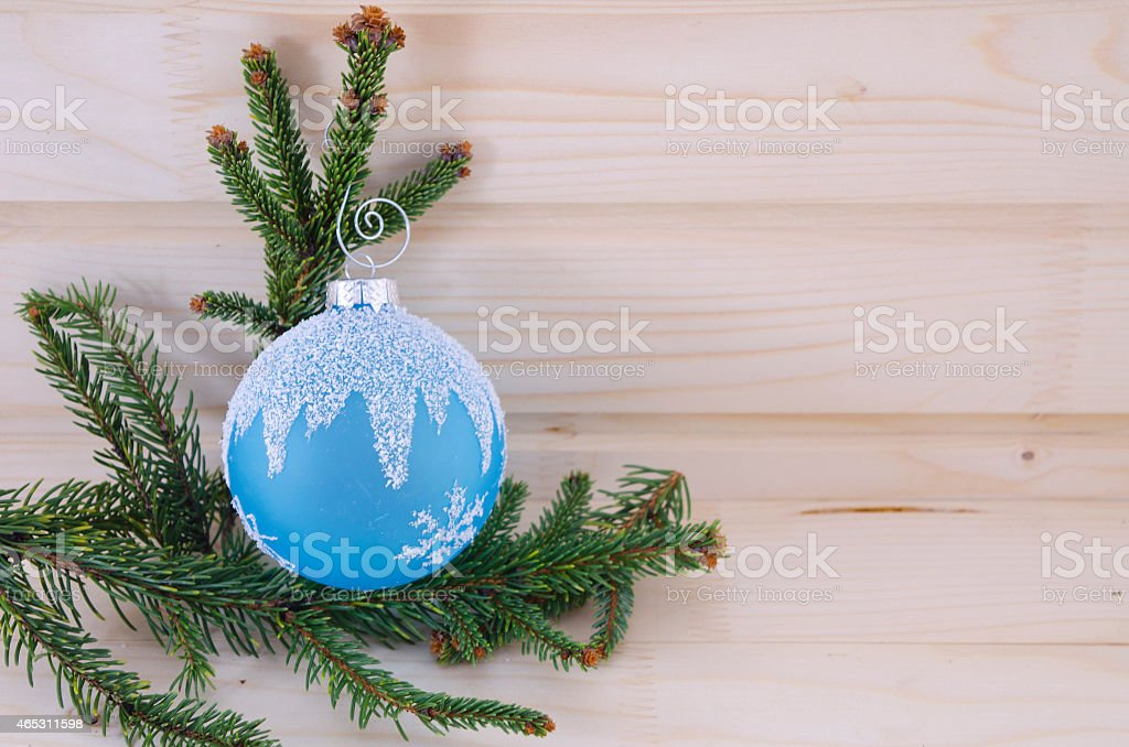 Blue Christmas ornament on a wooden table royalty-free stock photo