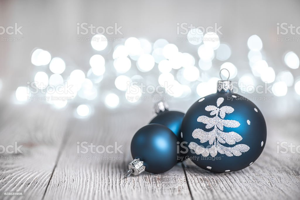 Blue Christmas Ornaments on Rustic Wood Background and defocused lights stock photo