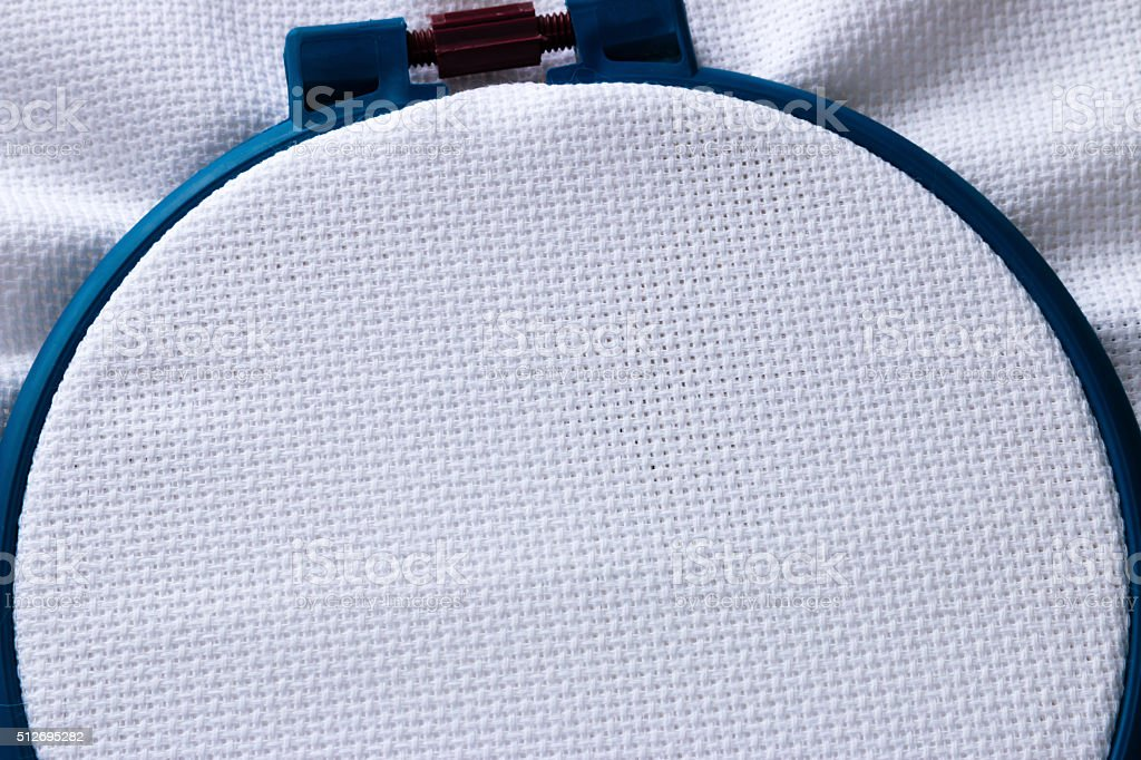 blue circle and the fabric for embroidery closeup stock photo