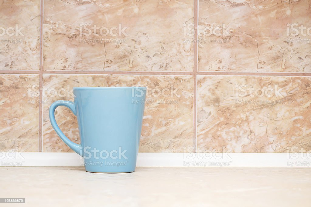 blue circle on the background of marble tiles royalty-free stock photo