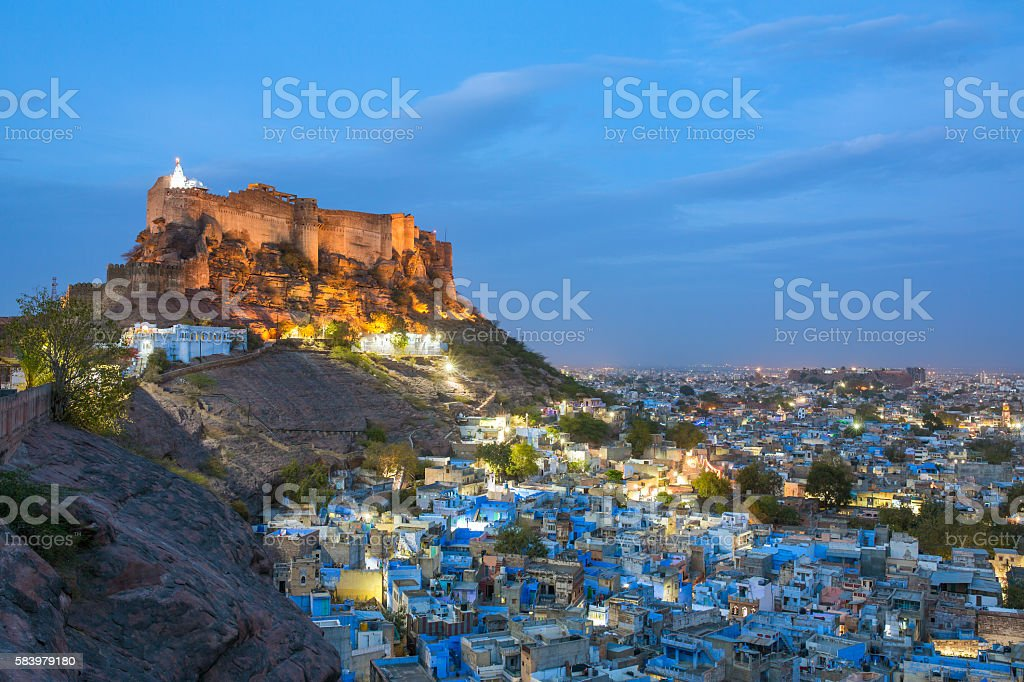 Blue city and Mehrangarh fort on the hill at night stock photo