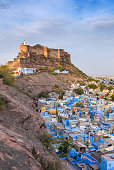 Blue city and Mehrangarh fort on the hill at night