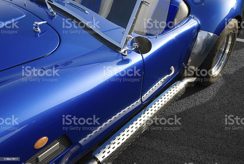 Blue classic American muscle car with chrome side exhaust royalty-free stock photo