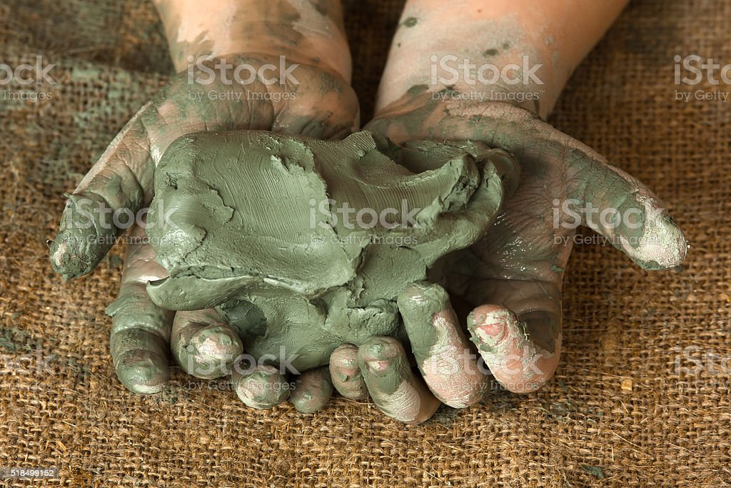 blue clay in the hands of child stock photo