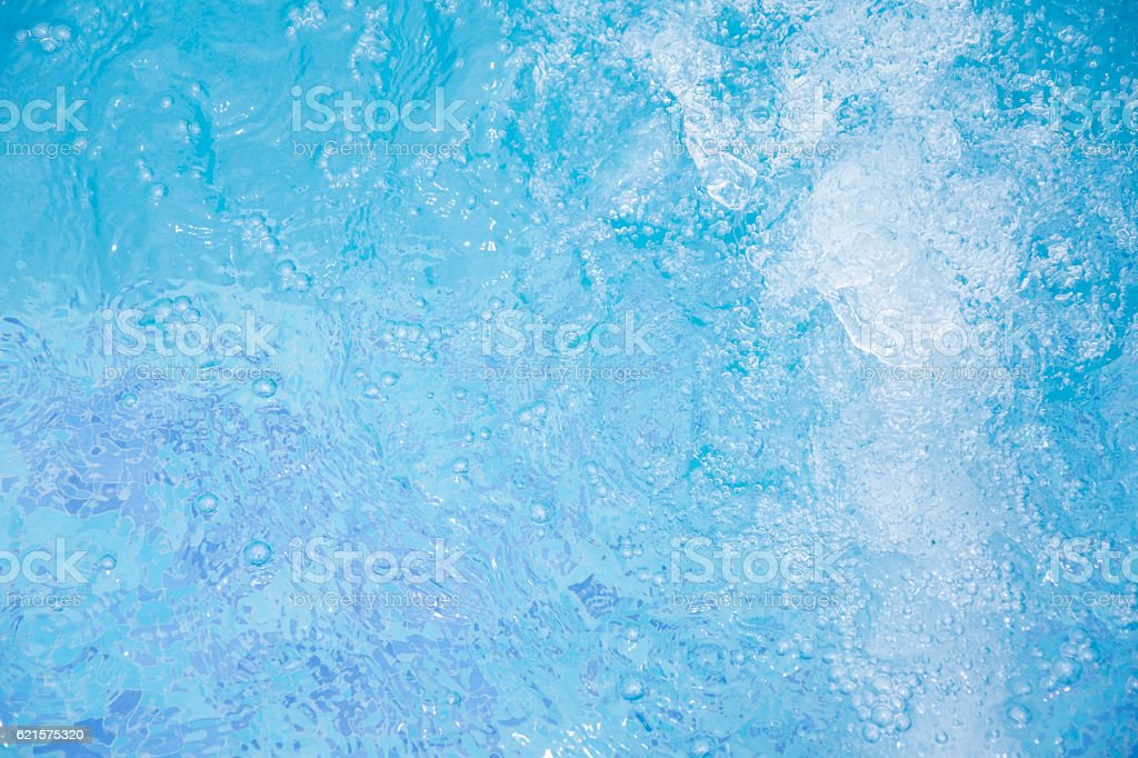 Blue clear fresh Water in jacuzzi. Spa massage background. stock photo