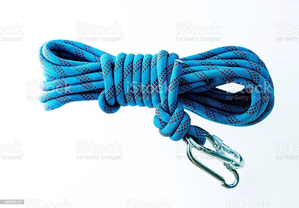 Blue climbing rope isolated on white background stock photo