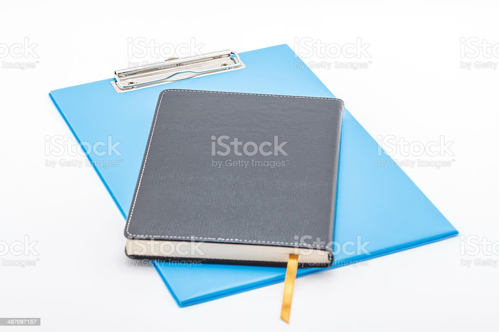 Blue clipboard and notebook. royalty-free stock photo