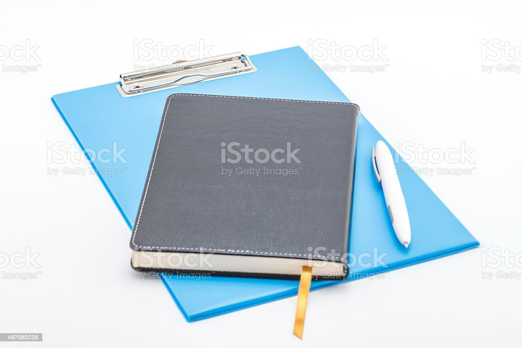Blue clipboard,notebook and pen. royalty-free stock photo