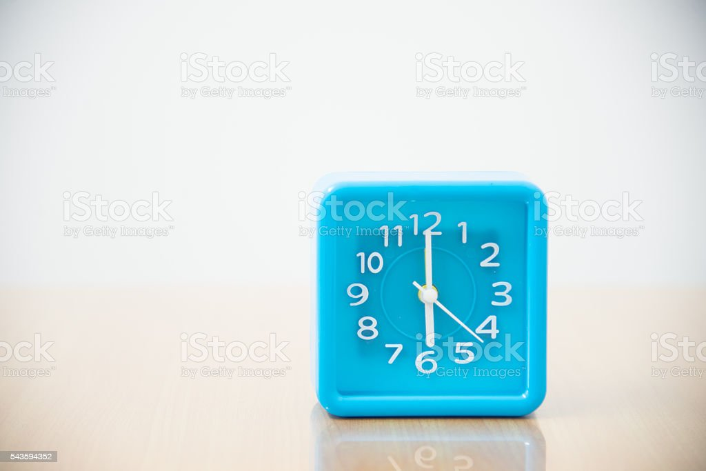 Blue clock on white tone. stock photo