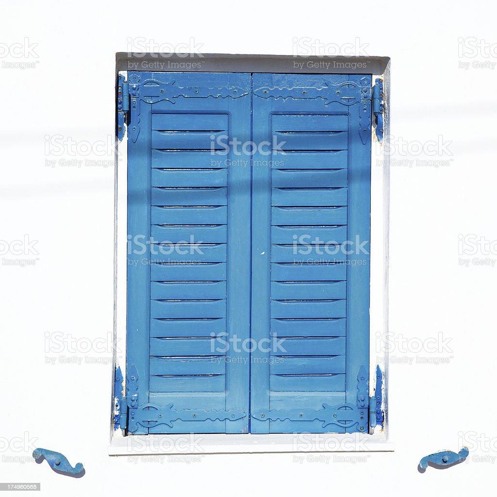 Blue closed shutters in Oia village, Santorini. Greece. royalty-free stock photo