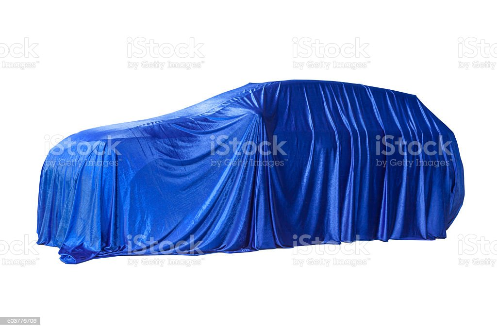 Blue cloth covers a new car stock photo