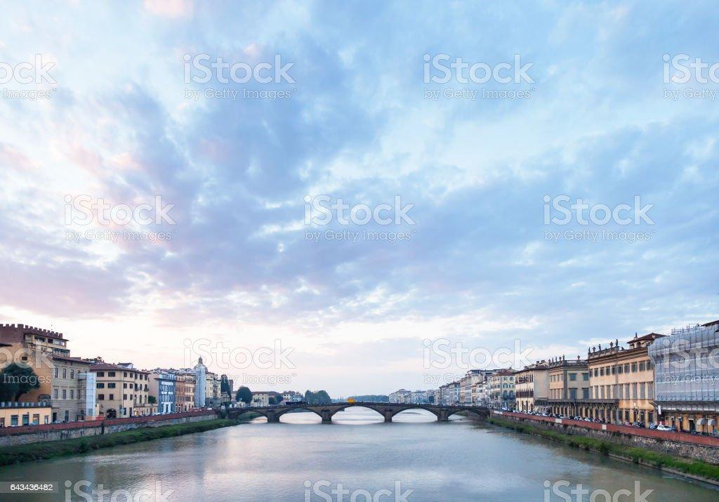 blue clouds over Arno River and Ponte alla Carraia stock photo