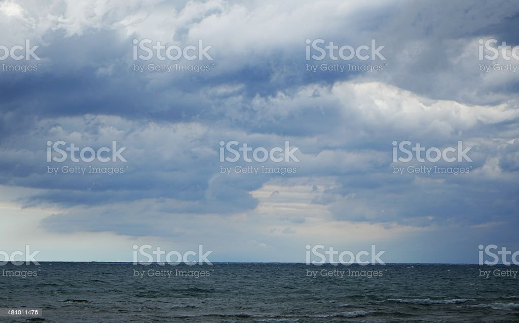 Blue Cloudy Sky Over Lake stock photo